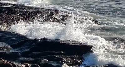 waves on rocks